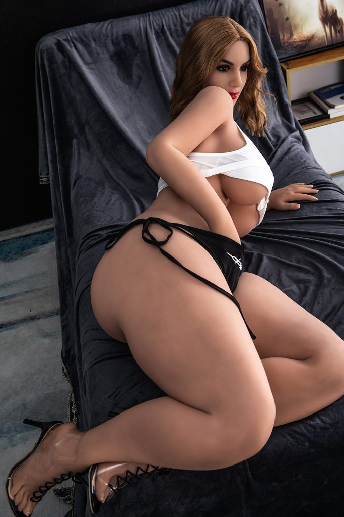 She goes back to fingering herself. Her pussy is wet and thirsty.