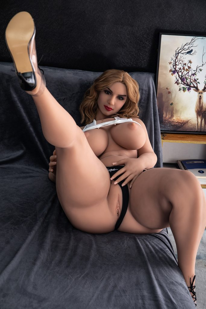 She goes back to the bedroom to finger herself with her legs open wide.